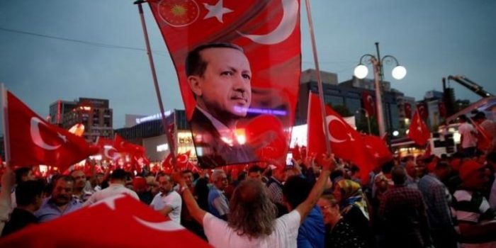 A supporter holds a flag depicting Turkish President Tayyip Erdogan during a pro-government demonstration in Ankara, Turkey, July 20, 2016. REUTERS/Baz Ratner/File Photo