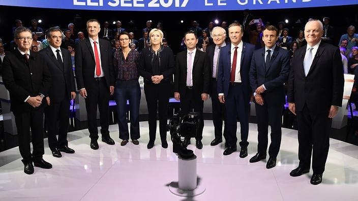 epa05888429 Ten of eleven French presidential election candidates: (L-R) far-left coalition La France insoumise (Unsubmissive France) Jean-Luc Melenchon; right-wing Les Republicains (LR) party Francois Fillon; lawmaker and independent candidate for France's 2017 presidential elections Jean Lassalle; far-left Lutte Ouvriere (LO) party Nathalie Arthaud, far-right National Front (FN) party Marine Le Pen;  left-wing French Socialist (PS) party Benoit Hamon; Solidarite et Progres (Solidarity and Progress) party Jacques Cheminade; right-wing Debout la France (DLF) party Nicolas Dupont-Aignan; En Marche! (Forward!) movement Emmanuel Macron and Popular Republican Union (UPR) party Francois Asselineau pose for a family picture prior to a debate organized by French private TV channels BFM TV and CNews, between the eleven candidates for the French presidential election, in La Plaine-Saint-Denis, France, 04 April 2017. French presidential election candidate for the far-left New Anticapitalist Party (NPA) Philippe Poutou refused to take part in the family picture.  EPA/LIONEL BONAVENTURE / POOL MAXPPP OUT
